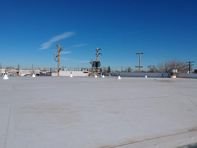 view of commercial roof of Greeley Inn
