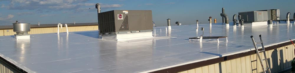 a commercial roof with a new rubber coating applied