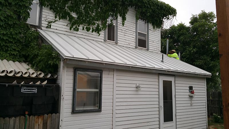 new metal roof with concealed fasteners on porch in Greeley, Colorado