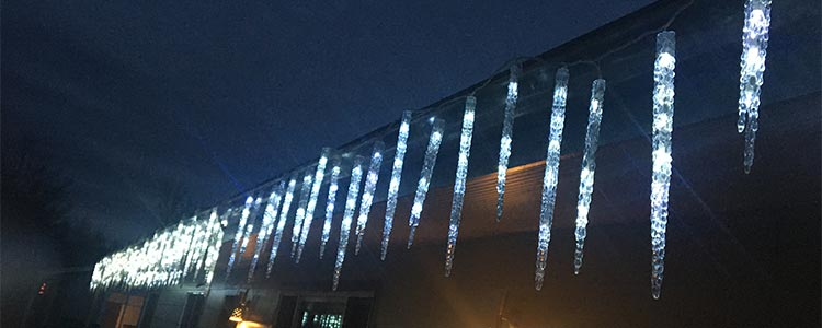 christmas lights on gutter at night