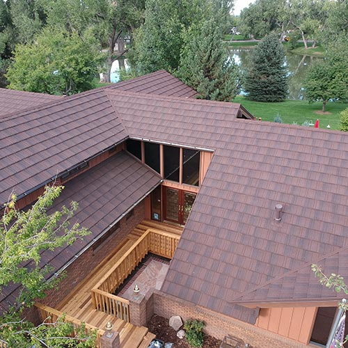 a new metal wood shake shingles on a house