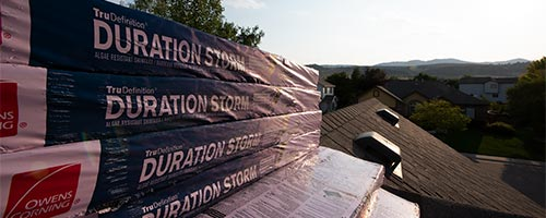 new roofing shingles on top of roof